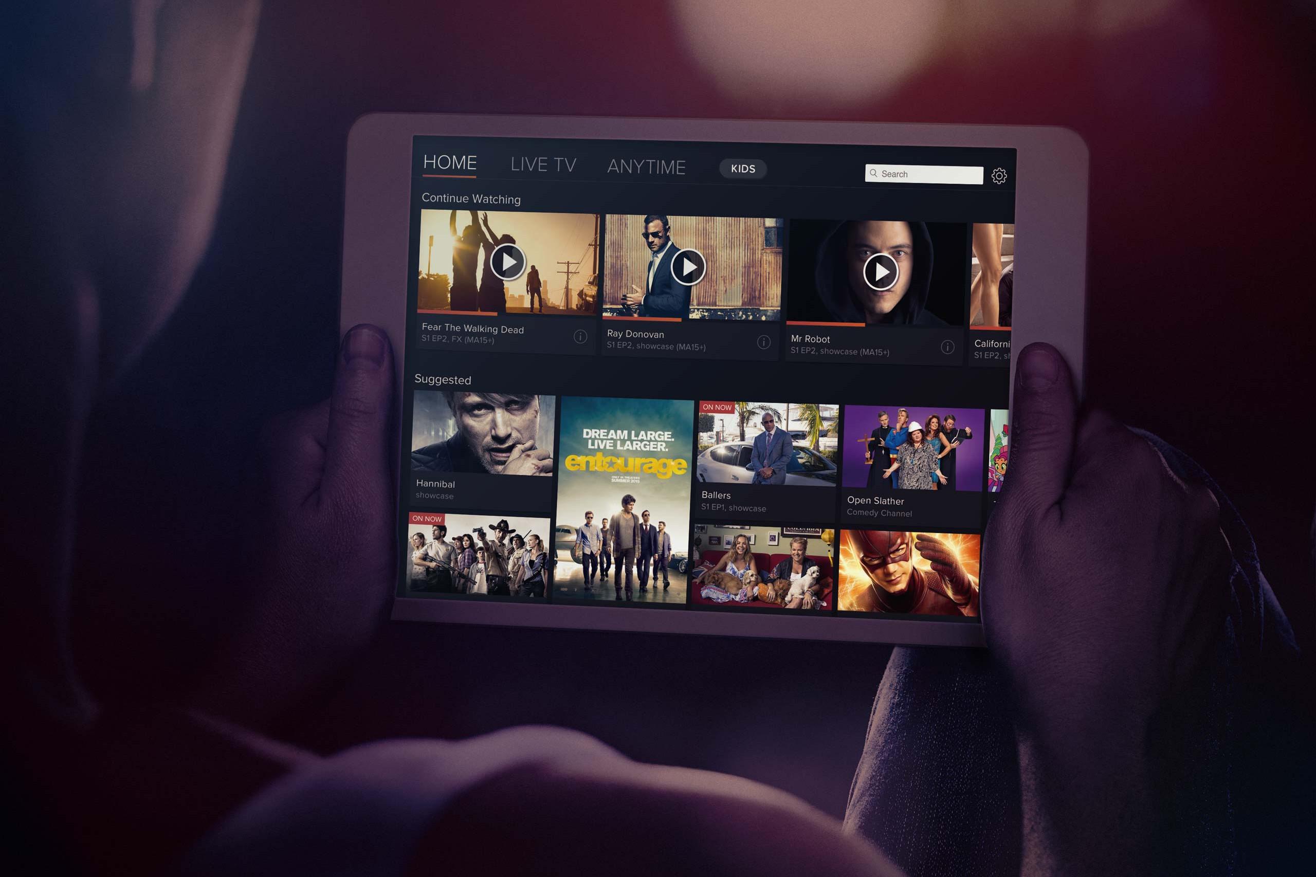 Foxtel Go iPad Man Holding iPad Mockup